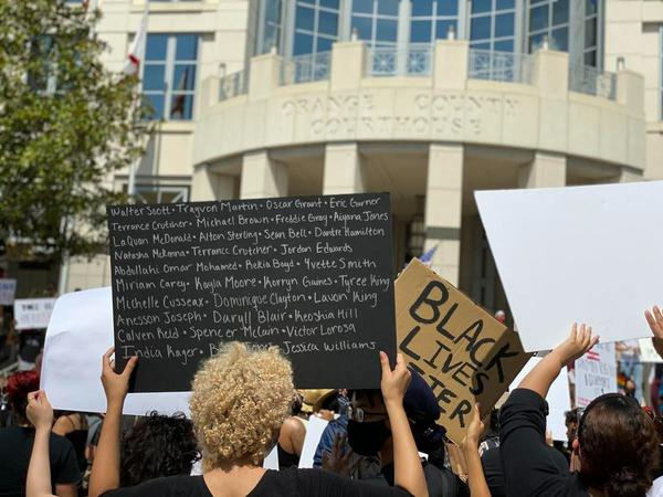 "Protesters marched through downtown Orlando on May 30 chanting ""say his name, George Floyd"" as they gathered in front of Orange County Courthouse."