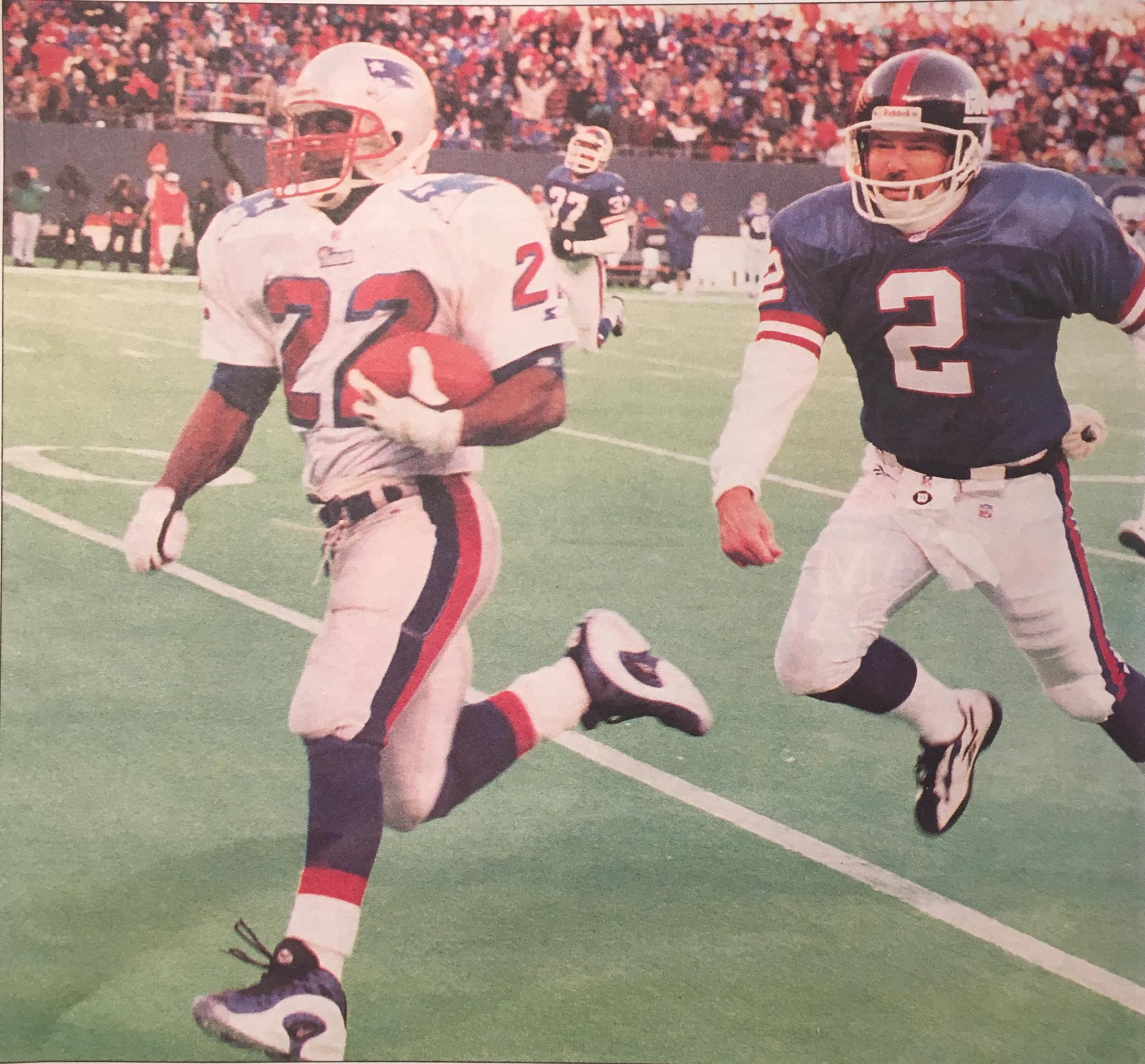 Dave Meggett outruns punter Mike Horan for a punt return for a touchdown.