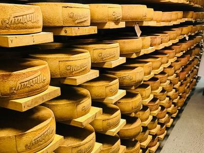 Rounds of cheese aging at Murray's Cheese Caves