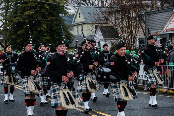 Pipers marching on River Road