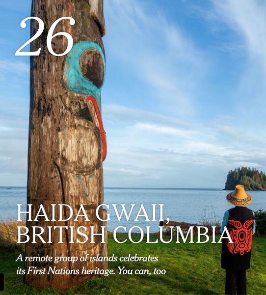 Photo of carved Haida totem pole with Watchman in Haida Gwaii, British Columbia