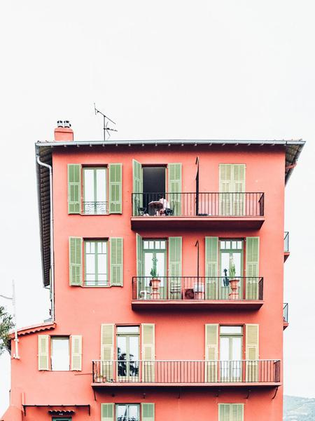 A pink apartment building