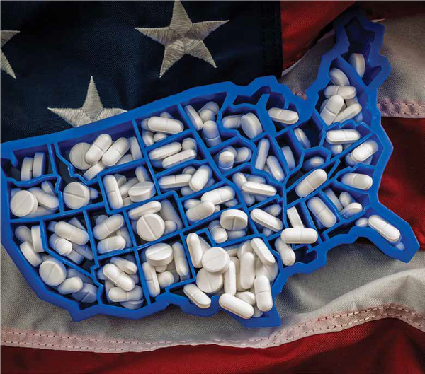 A pill holder shaped like America on top of an American flag