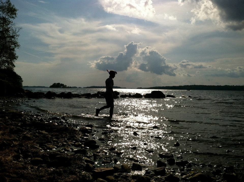 Benny Regalbuto walking into the sunset to go snorkeling