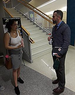 Two people standing and talking to each other at Ohio University