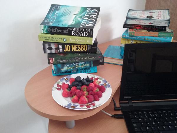 Laptop, books and fruit