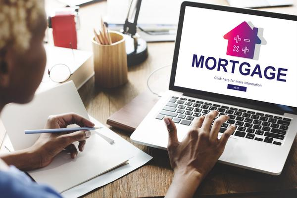 Comparing mortgages on laptop