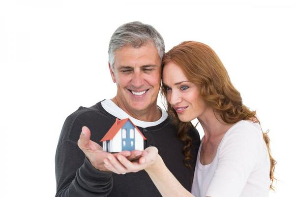 Couple look at small house